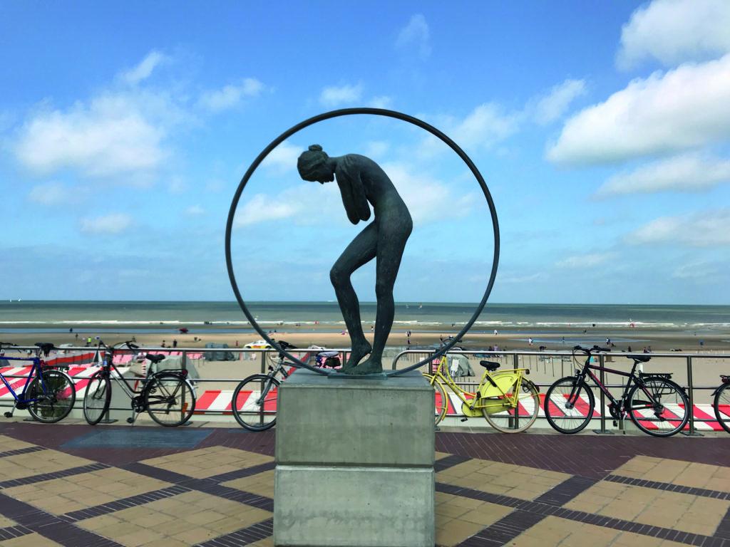 Woman sculpture on the promenade in De Haan
